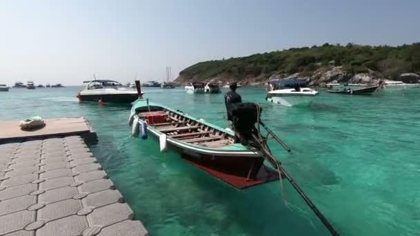 Phuket, Thailand - March 27, 2018 : Long tail boat at Patok Bay, Koh Racha Yai Island