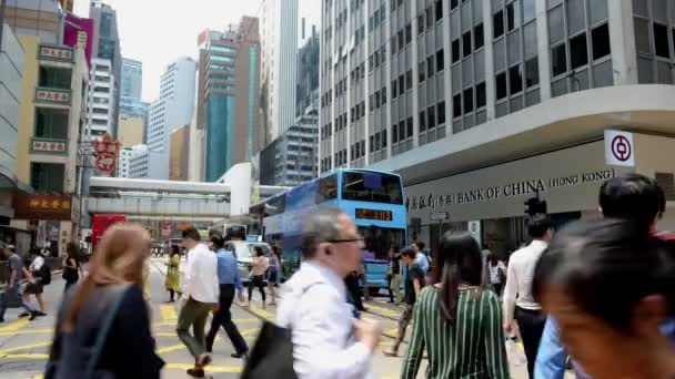 Hong Kong, China - August 15, 2018 : Time lapse of pedestrians and traffic with tram at Hong Kong