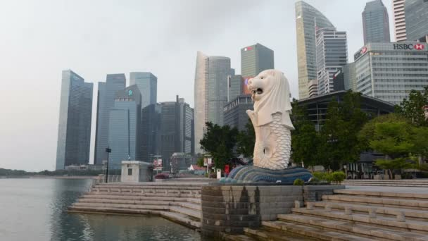 Singapore, Singapore - August 16, 2018 : Time lapse of Merlion statue fountain with the city skyline, Marina Bay