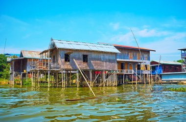 The stilt houses of Inpawkhon village, located on Inle Lake and famous for its numerous handicraft workshops, scenic lakescapes and countryside scenes, Myanmar.