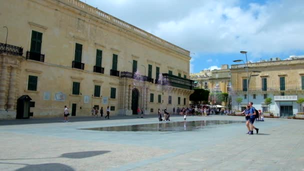 VALLETTA, MALTA - JUNE 17, 2018: Grandmaster's Palace, nowadays housing museums and President's office, located on Republic street and facing St George Square with fountains, on June 17 in Valletta.