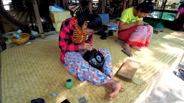 BAGAN, MYANMAR - FEBRUARY 25, 2018: Traditional lacquerware workshop is open for tourists to represent long and hard process of creating authentic Burmese lacquer pieces, on February 25 in Bagan.