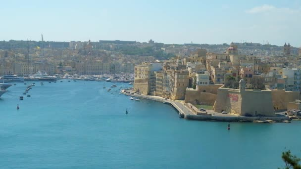 The viewpoint terrace in Herbert Ganado Gardens of Floriana opens the view on Grand Harbour of Valletta with picturesque medieval city of Senglea and Vittoriosa Marina with yachts and boats, Malta.
