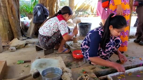 PINDAYA, MYANMAR - FEBRUARY 19, 2018:  The workers of family paper workshop demonstrate the process of traditional Shan paper production, made of mulberry tree fibers, on February 19 in Pindaya.