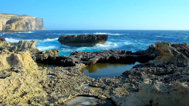 Explore the rocky coastline of San Lawrenz, famous among the tourists for its amazing landscapes, perfect place for romantic walks, observing of cliffs and stormy sea, Gozo Island, Malta.