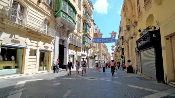 VALLETTA, MALTA - JUNE 17, 2018: Republic street, lined with historical edifices, small cafes and bars, fashion boutiques and art galleries, is the central city location, on June 17 in Valletta