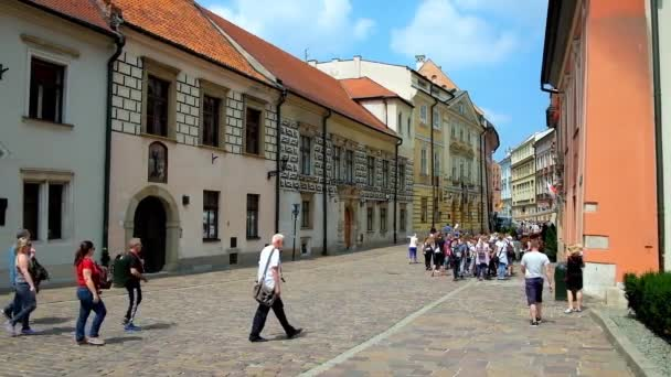 KRAKOW, POLAND - JUNE 11, 2018: Kanonicza street is lined with beautiful historical mansions and palaces, decorated with murals and reliefs and serving as city museums, on June 11 in Krakow.