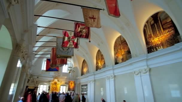CZESTOCHOWA, POLAND - JUNE 12, 2018: Historic Knights Hall of Jasna Gora Monastery with colorful banners above the windows, on June 12 in Czestochowa.