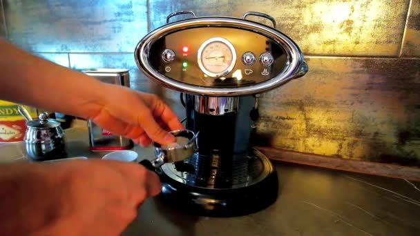 NAPLES, ITALY - SEPTEMBER 19, 2018: Preparing of waking cup of morning espresso in luxury vintage styled FrancisFrancis home coffee machine with Illy ESE coffee pod, on September 19 in Naples.