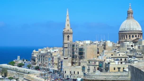 St Andrew bastion overlooks the bell tower of St Paul's Anglican Pro-Cathedral and dome of Carmelite Church - one of the most stunning city landmarks, dominating the skyline, Valletta, Malta.