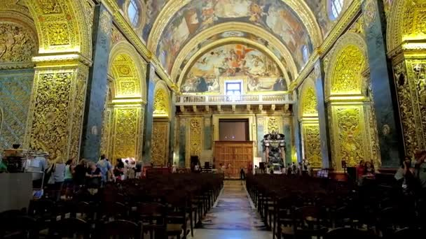 VALLETTA, MALTA - JUNE 18, 2018: Splendid Nave of St John's Co-Cathedral with ornate decoration of walls and vaulted ceiling, including carvings and paintings by Mattia Preti, on June 18 in Valletta.