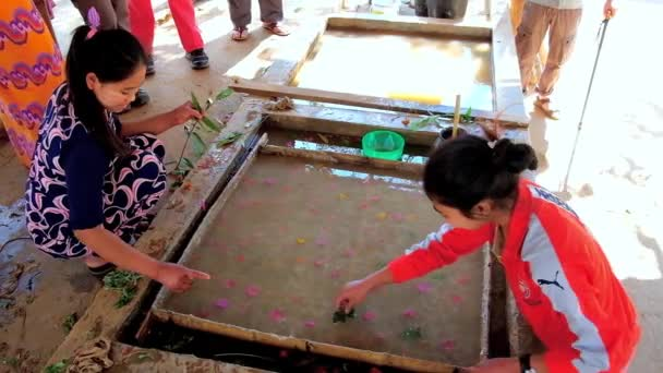 PINDAYA, MYANMAR - FEBRUARY 19, 2018: Demonstration of natural Shan paper production from botanical ingredients, using old traditional technology, on February 19 in Pindaya.