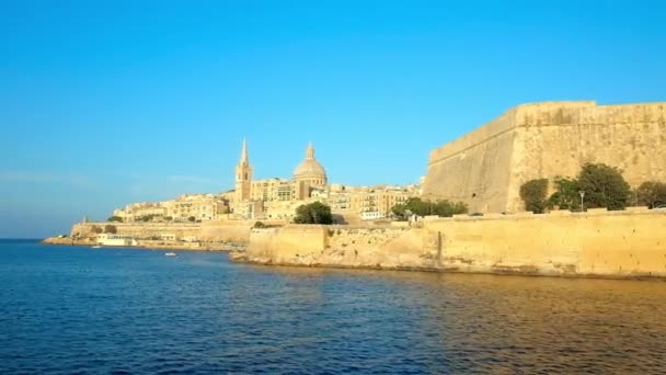 Enjoy the medieval architecture of Valletta with its main symbols - St Paul's Anglican Pro-Cathedral, Carmelite Church and ramparts, illuminated by the bright sun rays, Malta.