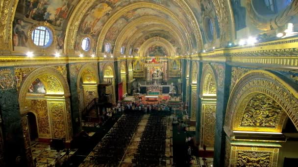 VALLETTA, MALTA - JUNE 18, 2018:  The richly decorated prayer hall of St John's Co-Cathedral with masterpiece paintings, ornate stucco carvings, gilt details and sculptures, on June 18 in Valletta.