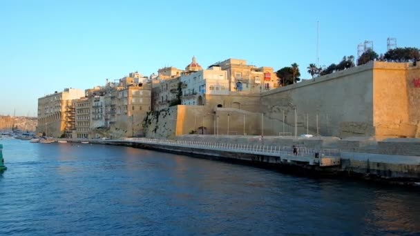 SENGLEA, MALTA - JUNE 19, 2018: The fortified city of L-Isla looks great from the sea, its tall ramparts and medieval edifices decorate Valletta Grand Harbour, on June 19 in Senglea.