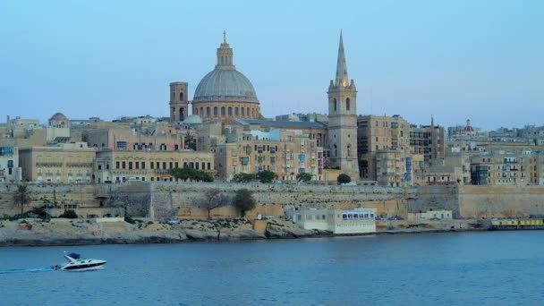 The stunning skyline of old Valletta with its churches and towers, ramparts and historic mansions from the Northern Harbour on blue hour, Malta.