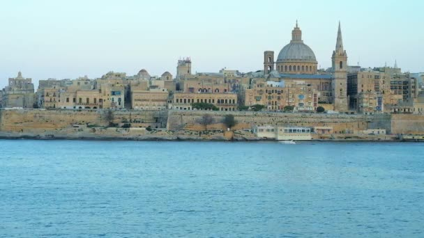 Enjoy historic Valletta city from the Northern Harbour, observe its tall belfries, huge domes and historic edifices behind the city wall, Malta.