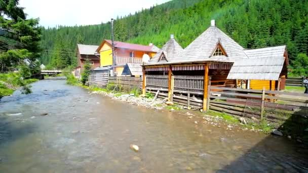 SYNEVYR, UKRAINE - JULY 1, 2018: Traditional Ukrainian restaurant in wooden  house - koluba, located on the bank of Tereblya river in Synevyrska  Polyana, Carpathian mountains, on July 1 in Synevyr