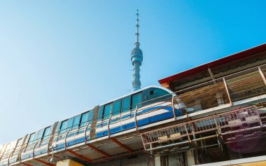 The modern train of Moscow Monorail line at the Teletsentr station with a view on Ostankino Tower on the background, Russia.