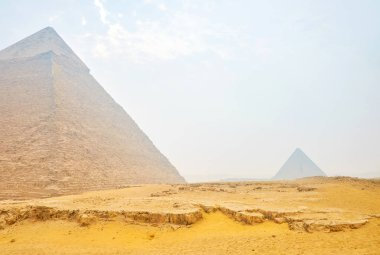 The Giza pyramid complex located in the midst of the sand dunes and often are shrouded with dust, Egypt