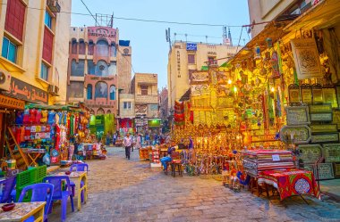 CAIRO, EGYPT - DECEMBER 20, 2017: Shops of Khan EL-Khalili Souq offers innumerable amount of interesting goods, bright Egyptian souvenirs and tasty tobacco, on December 20 in Cairo.