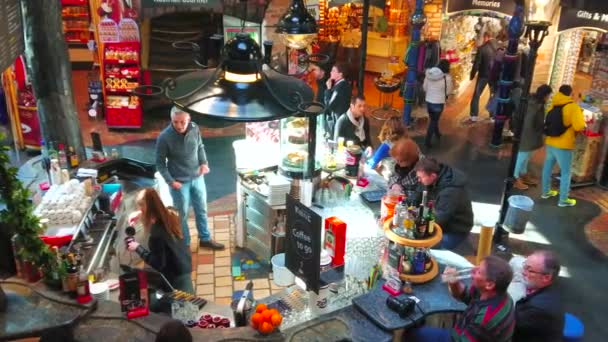 VIENNA, AUSTRIA - FEBRUARY 19, 2019: The bar amid the hall of Hundertwasser Village - the covered market, like Oriental Bazar with many handicraft stalls and unique interior, on February 19 in Vienna.