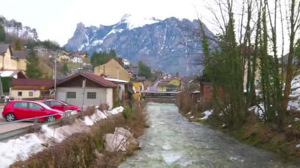 Enjoy Alpine landscape and traditional architecture of Salzkammergut, observing narrow Traun river and small town of Ebensee, Austria.