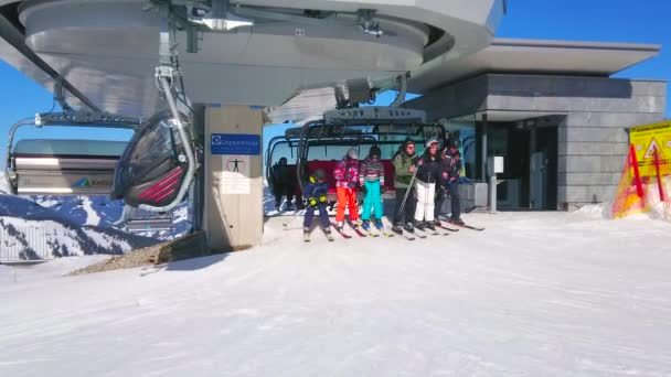 ZELL AM SEE, AUSTRIA - FEBRUARY 28, 2019: The skiers and boarders arrive to the top station of Kettingbahn chairlift, located on peak of Schmitten mountain, on February 28 in Zell Am See.