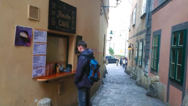 Vienna Austria February 19 2019 The Tourist Buys Traditional Coffee In Small Stylish Fenster Cafe Tiny Kiosk In Historic House Wall Hidden In Old Town On February 19 In Vienna