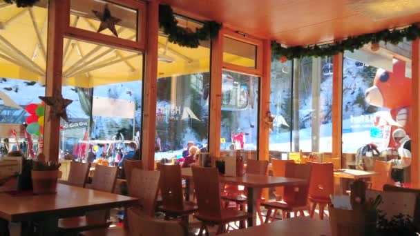 ZELL AM SEE, AUSTRIA - FEBRUARY 28, 2019: The view through the hall of lounge cafe on riding tram of Schmittenhohebahn cable car and gondolas of Trassxpress, on February 28 in Zell Am See.