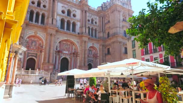 MALAGA, SPAIN - SEPTEMBER 26, 2019: The old Plaza Obispo square is best place to relax in outdoor cafe amid historical landmarks, such as Bishops Palace and Cathedral, on September 26 in Malaga