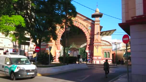 MALAGA, SPAIN - SEPTEMBER 26, 2019: The traffic in front of Neo-Mudejar style Salamanca Market with arabesques, carvings, horse-shoe portal and small towers on the sides, on September 26 in Malaga