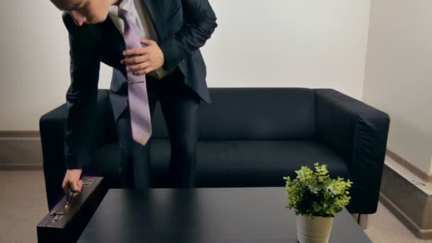 Businessman on the couch with hand spinner