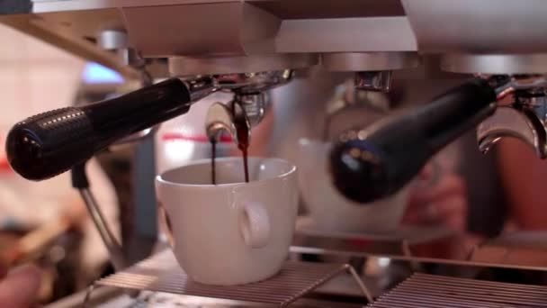 Coffee maker pouring coffee at cafe