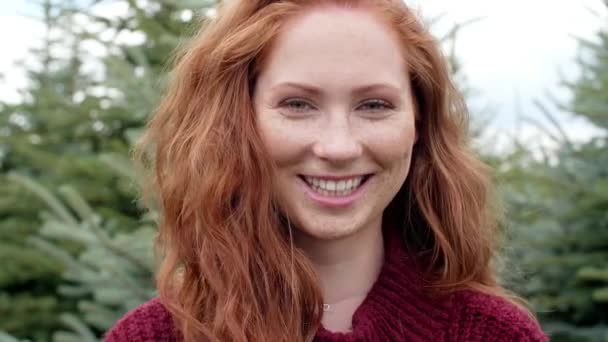 Portrait of red haired woman smiling