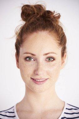 Portrait of beautiful woman smiling at studio shot