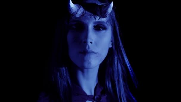 Woman in devil costume scaring