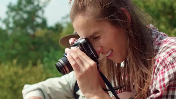 Woman taking a photo during hiking trip