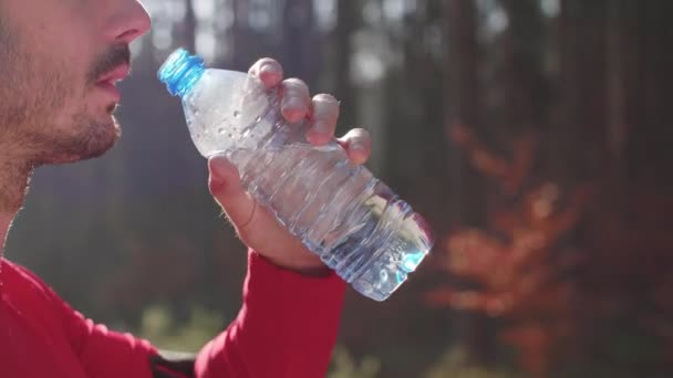 Man drinking water after hard workout