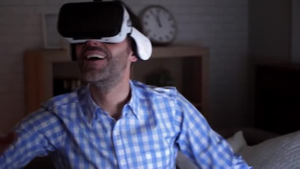 Excited man wearing virtual reality glasses