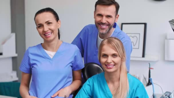 Portrait of three, smiling dentists in dentists clinic