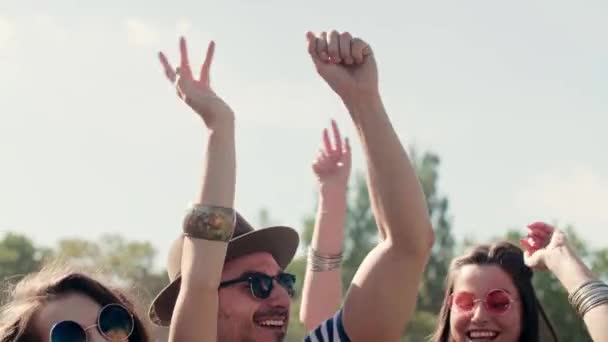 Group of people with their hands raised