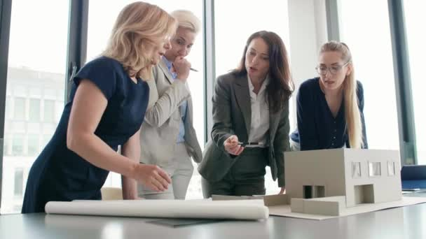 Team of four female architects at work