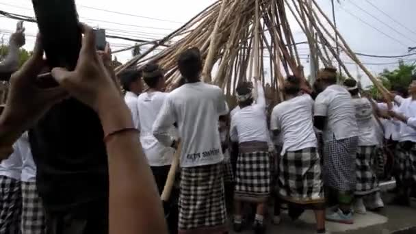 Desa Munggu, Kabupaten Badung, Bali, Indonesia - February 29, 2020: Ceremony Mekotek is a heritage that has been professed by Hindus in Bali for centuries. A rite with long sticks held by men.