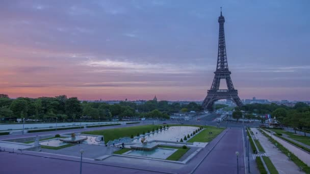 France, Paris. Morning. The Eiffel Tower and the Trocadero gardens. Colorful sky and fast clouds. Time lapse