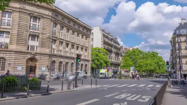 France, Paris - May 28, 2019: Sunny summer day. Plton traffic at the crossroads of two streets. Traffic lights. Clouds run fast. Time lapse