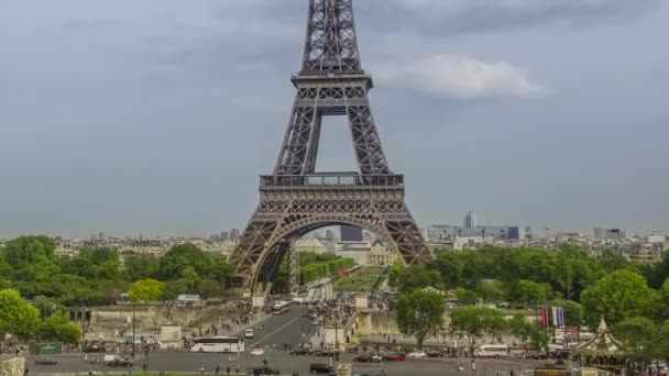 France. Paris. Summer evening. Overcast over the Eiffel Tower. Car and human traffic on the Jena bridge. Time lapse