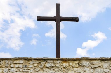 A large wooden cross against the sky.