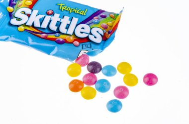 Skittles fruit-flavoured candies isolated on white background.