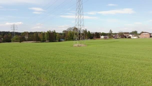 Power pylons and high voltage lines in an agricultural landscape. High-voltage masts. Electricity transmission power lines.4K, UHD, Cinematic, Aerial footage